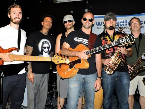The International Hustlers in Studio B at Radio Bandiego.